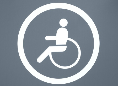 Disabled sign in white over a red background photo