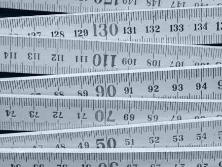 Detail of a wooden metric carpenter ruler Stock Photo