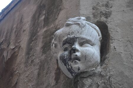 Detail of an ancient Venetian mask in the city of Venice (Venezia) in Italy photo
