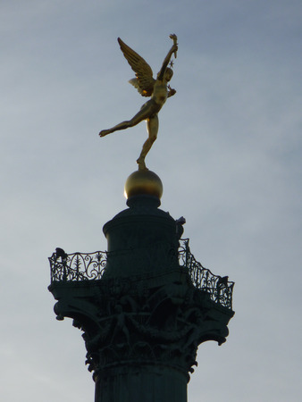 Obelisque in Place de la Bastille square in Paris France photo