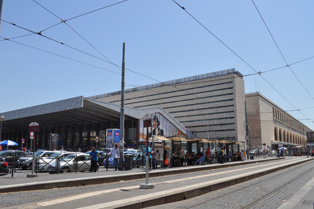 ROME, ITALY - JUNE 23, 2014: People waiting for tram in front of Roma Termini central railway station Редакционное