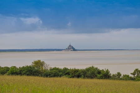Mont Saint Michel island commune with Abbey and fortifications in Normandy France photo