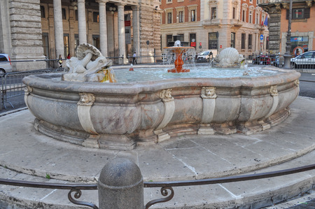 sculpted: Fountain in Piazza Colonna square designed by Giacomo Della Porta and sculpted by Rocco Rossi in 1577 in Rome Italy Editorial