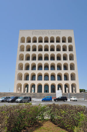 ROME, ITALY - JUNE 23, 2014: The Palazzo della Civilta Italiana aka Palazzo della Civilta del Lavoro or Colosseo Quadrato meaning Square Colosseum is an icon of Fascist architecture designed by Marcello Piacentini