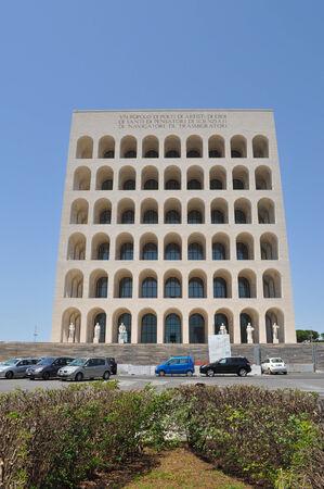 fascist: ROME, ITALY - JUNE 23, 2014: The Palazzo della Civilta Italiana aka Palazzo della Civilta del Lavoro or Colosseo Quadrato meaning Square Colosseum is an icon of Fascist architecture designed by Marcello Piacentini