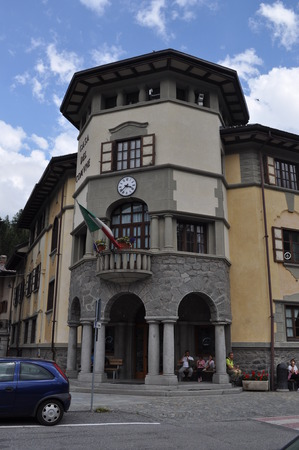 municipal editorial: CESANA, ITALY - JULY 06, 2014: People in front of Town hall in the city of Cesana in Piedmont Italy Editorial