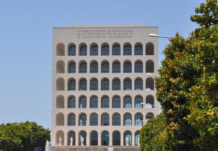 rationalism: ROME, ITALY - JUNE 23, 2014: The Palazzo della Civilta Italiana aka Palazzo della Civilta del Lavoro or Colosseo Quadrato meaning Square Colosseum is an icon of Fascist architecture designed by Marcello Piacentini