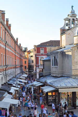 visiting: VENICE, ITALY - AUGUST 18, 2014: Tourists visiting the city of Venice in Italy Editorial
