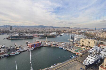 montjuic: BARCELONA, SPAIN - FEBRUARY 16, 2015: Aerial view of Port torre de Sebastia harbour seen from Belvedere miramar on Montjuic hills