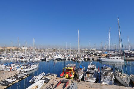 summer olympics: BARCELONA, SPAIN - FEBRUARY 16, 2015: Port Olimpic meaning Olympic Harbour is a marina east of the Port of Barcelona which hosted the sailing events for the 1992 Summer Olympics Editorial
