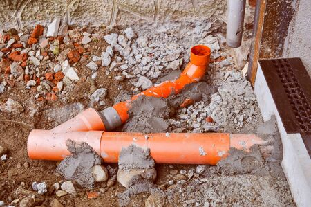 pipework: Vintage looking Plastic pipework for underground waste water Stock Photo