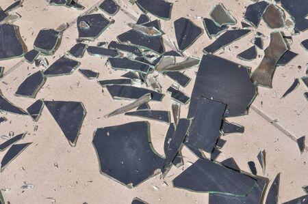 shards: Broken mirror glass shards spread on the floor