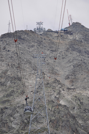 aosta: AOSTA VALLEY, ITALY - AUGUST 06, 2015: The new SkyWay aerial tramway links the city of Courmayeur with Pointe Helbronner on the top of Mont Blanc massif