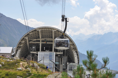 courmayeur: AOSTA VALLEY, ITALY - AUGUST 06, 2015: The new SkyWay aerial tramway links the city of Courmayeur with Pointe Helbronner on the top of Mont Blanc massif