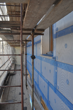 thermal insulation: Thermal Insulation of an external wall with insulation boards in building site