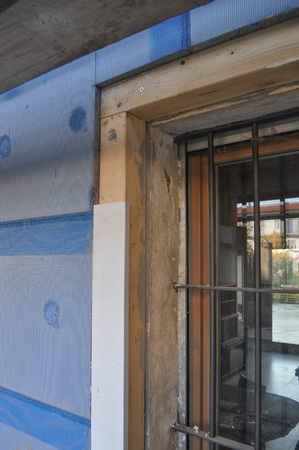 building external: Thermal Insulation of an external wall with insulation boards in building site