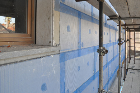 Thermal Insulation of an external wall with insulation boards in building site