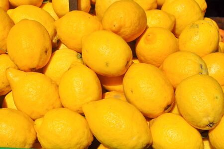 limon: Yellow Yellow lemon (Citrus x limon) fruit vegetarian food Stock Photo