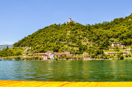 LAKE ISEO, ITALY - CIRCA JUNE 2016: High_dynamic_range (HDR) The Floating Piers site specific artwork by Christo and Jeanne Claude