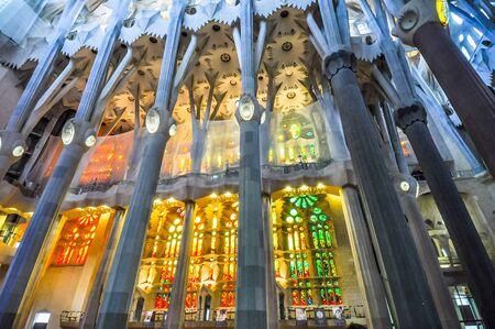 BARCELONA, SPAIN - FEBRUARY 17, 2015: High_dynamic_range (HDR) Interior of the Sagrada Familia Roman Catholic church designed by Catalan architect Antoni Gaudi