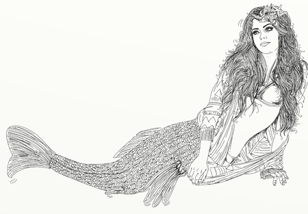 Long-haired mermaid leaning to her side and facing the viewer Stock Photo
