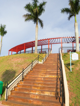 Guararema, S o Paulo, Brazil, stairs of the View of the city with gardens and palm trees in day of sun.