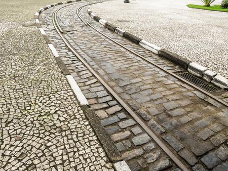 Urban tram track on stone street. City of Santos, Brazil
