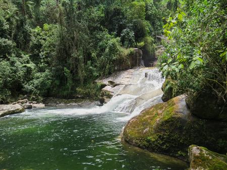 January 7, 2016, Itatiaia, Rio de Janeiro, Brazil, beautiful Itaporani Waterfall in the middle of the forest of Itatiaia National Park.