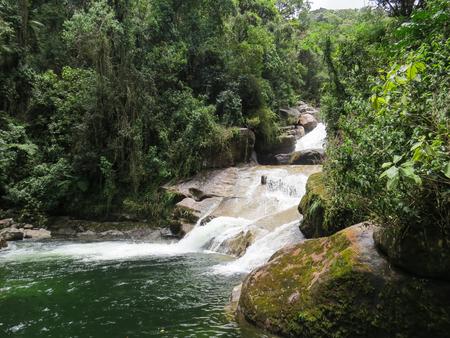 January 7, 2016, Itatiaia, Rio de Janeiro, Brazil, forest with the Itaporani Waterfall amid the forest of the Itatiaia National Park on a sunny day.