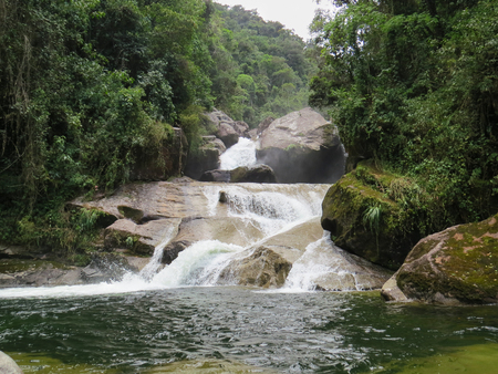 January 7, 2016, Itatiaia, Rio de Janeiro, Brazil, beautiful Itaporani Waterfall in the middle of the forest of the Itatiaia National Park on a sunny day.