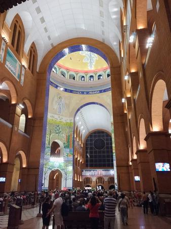 March 24, 2018, Aparecida, Sao Paulo, Brazil, pilgrims under arches of the Basilica of Our Lady Aparecida, during night worship.