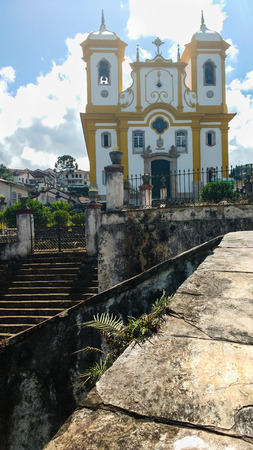 March 25, 2016, historic city of Ouro Preto, Minas Gerais, Brazil, facade and stairs of the Mother Church of Our Lady of Conception, on a sunny day.