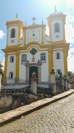 March 25, 2016, historic city of Ouro Preto, Minas Gerais, Brazil, view of the street and facade of the Mother Church of Our Lady of Conception on a sunny day.