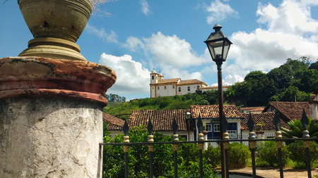 March 25, 2016, historic city of Ouro Preto, Minas Gerais, Brazil, garden and light in the foreground and church in the background. Editorial