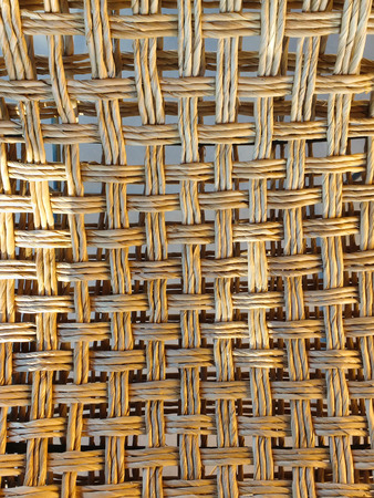 Close up of woven straw plaid texture on cross.