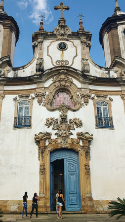 March 25, 2016, historic city of Ouro Preto, Minas Gerais, Brazil, facade and main door of the Church of Our Lady of Carmo, with tourists ahead. Editorial