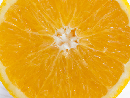 Close-up of half of juicy orange sliced. Healthy and colorful food.