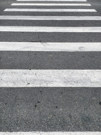 View of the pedestrian crossing horizontal, quite worn.