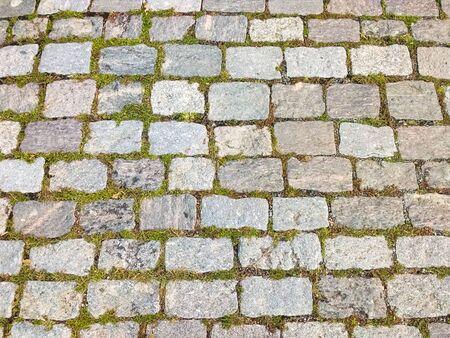Top view of old street floor of granite stones horizontally. Banco de Imagens