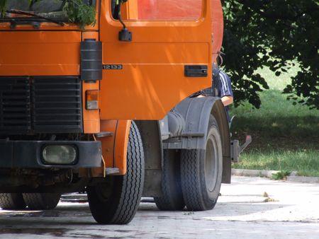 numberplate: A big orange truck rear