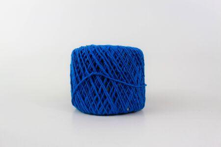Blue yarn closeup isolated on white background Фото со стока