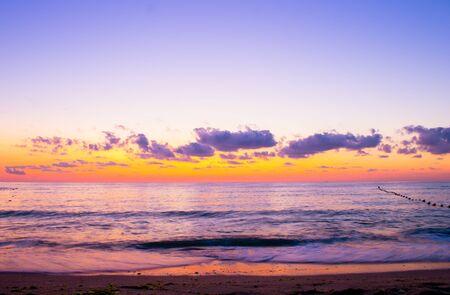 Beautiful cloudscape over the sea, colorful sea beach sunrise