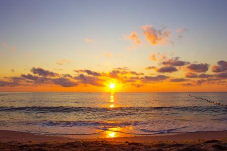 Beautiful cloudscape over the sea, colorful sea beach sunrise. Sea in sunrise nature landscape.