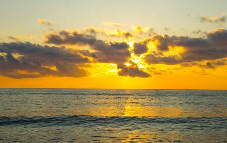 Cloudscape over the sea, colorful sea beach sunrise. Sea in sunrise nature landscape.