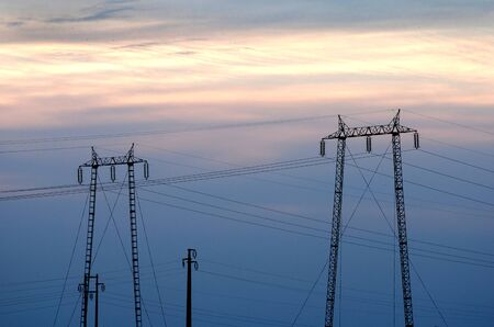 over voltage: High voltage electricity pylon over sky Stock Photo