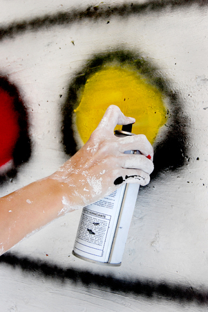 Spray painting on wall Stock Photo