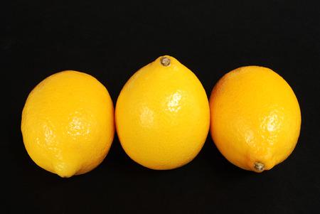 Lemons on black background Stock Photo - 1637036