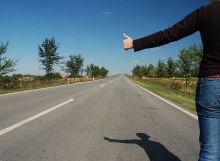 Hitch hike on a road Stock Photo - 1806358