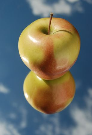 Apple on mirror with sky and clouds Stock Photo - 1849914