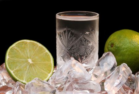 Cold drink in crystal glass and lime Stock Photo